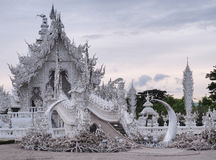 Wat Rong Khun (The White Temple) under cloudy sky with reflection from pond Royalty Free Stock Image