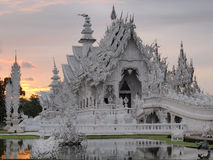 Wat Rong Khun (The White Temple) under sunset sky Stock Photography