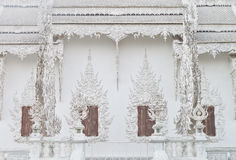 Wat Rong Khun window. Stock Photo