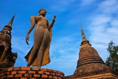 Wat Sa Si Sukhothai Historical Park. Buddhist sculpture. Buddha statue walking. Sukhothai Historical Park, Travel Asia Royalty Free Stock Photos