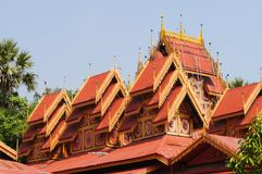 Wat Sri Rong Muang has the most beautiful teak wood vihara in La. Mpang. It is said to be the same as Indra`s place.The roof has multiple layers Some parts of royalty free stock photography