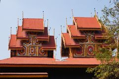 Wat Sri Rong Muang has the most beautiful teak wood vihara in La. Mpang. It is said to be the same as Indra`s place.The roof has multiple layers Some parts of stock photography