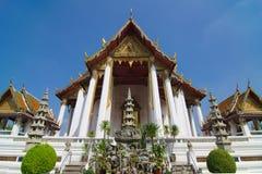 Wat Suthat Thep Wararam. (Thai: วัดสุทัศนเทพวราราม, Thai pronunciation: [wát su.tʰát tʰêːp.wáʔraːraːm]) is a Stock Photo