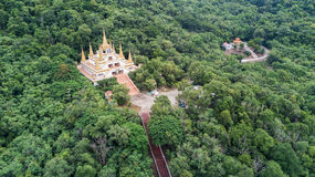 Wat Tham Phra that Khao Prang in Lopburi, Thailand. Aerial scene from drone of the temple build on the moutain in forest and very famous; Wat Tham Phra that Khao Stock Photos