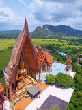 Wat Tham Sua(Tiger Cave Temple). A view from the top of the pagoda, golden buddha statue with rice fields and mountain, Wat Tham Sua(Tiger Cave Temple), Tha Royalty Free Stock Photo