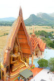 Wat Tham Sua. A view from the top of the pagoda, golden buddha statue with rice fields and mountain at Wat Tham Sua (Tiger Cave Temple), Kanchanaburi thailand Stock Photos