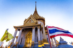 Wat Traimit and flags Stock Photography