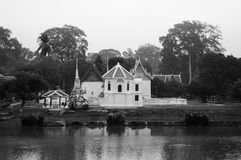Wat Uposatharam temple or Wat Bot by the calm river of Uthaithan. Wat Uposatharam temple or Wat Bot by the calm river with reflection on river surface Royalty Free Stock Image