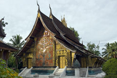 Wat Xieng Thong in Luang Prabang. Wat Xieng Thong is one of the most important temples in the country of Laos. The back of temple with its famous tree of life Stock Photos