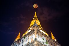 Wat Yai Chai Mongkol Ayutthaya Thailand At night. With a full moon. pagoda Royalty Free Stock Images