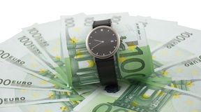 Watch and 100 euros isolated on a white. Royalty Free Stock Photos