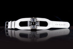 Watch. Luxury white woman watch with cross on black background royalty free stock images