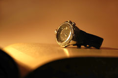 Watch. Sepia toned watch on an open book Royalty Free Stock Photos