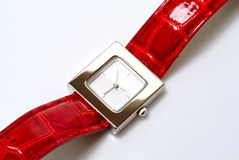 Watch. Square watch with a red leather wristlet Royalty Free Stock Photo