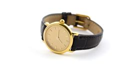 Watch. A female golden wrist watch with leather wristlet Stock Images