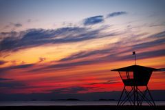 On Watch. A lifeguards post facing the sunset Stock Image
