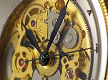 Watch. The movement of a classic golden watch royalty free stock images