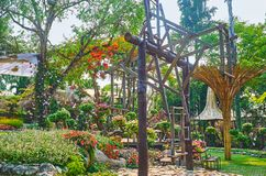 Explore Akha hill tribe swing, Mae Fah Luang garden, Doi Tung, Thailand. Watch the Akha hill tribe swing among the scenic flower beds of Mae Fah Luang garden stock photo