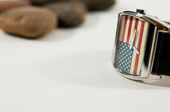 A watch America flag in background watch. Focus on America flag in background watch, fashion watch 4th July, God Bless America, America flag Stock Image