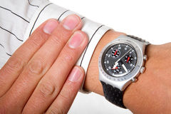 Watch on arm. A man checking the time on his wrist watch Stock Photography