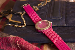 Watch and bag on scarves. Pink watch and blue bag on scarves Stock Images