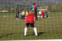 Watch the ball. Goalkeeper watching the game during boys friendly match in england Stock Photos