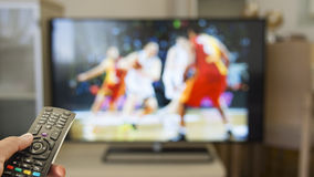 Watch basketball sport on TV. Watch basketball on TV with remote control Stock Image