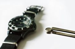 Watch battery replacement. Watchmaker replacing watch battery on quartz watch Stock Photos