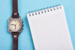 Watch and a blank notepad Stock Photos