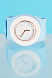 Watch on a blue background Royalty Free Stock Photo