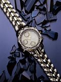 Watch on Blue Glass. Still life of watch on Blue Glass Royalty Free Stock Image