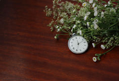 Watch and bouquet Royalty Free Stock Image