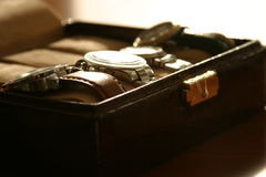 Watch box. Leather box containing watches in a backlight Royalty Free Stock Photos