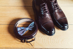 Watch, Brown bow tie, leather shoes and belt. Grooms wedding morning. Close up of modern man accessories Stock Images