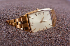 Watch buried in sands Royalty Free Stock Photo