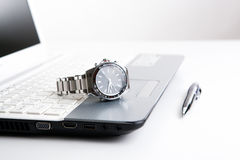 Watch businessman on the laptop keyboard Royalty Free Stock Photography