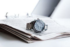 Watch businessman on newspaper Royalty Free Stock Images
