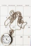 Watch on calendar Stock Image
