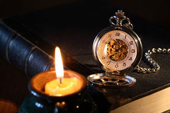 Watch And Candle Stock Image
