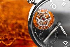 Watch. Case on orange background Royalty Free Stock Image