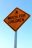 Watch for Children sign. Children playing. Caution Stock Photo