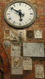 Watch on church wall. A big watch on the wall of an Italian church Royalty Free Stock Photos