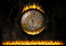 Watch clock fiery. The elapsed time. Concept of burn time, urgency. A wall clock caught fire. Under this watch a long fiery zone. Concept of urgency or speed of Royalty Free Stock Photo