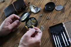 Watch clock repair retro concept working hard in a past Stock Photo