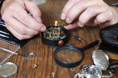 Watch clock repair retro concept working hard in a past Stock Photos