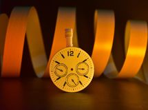 Watch or clock with yellowish background photograph. The beautiful round shape clock or watch with unique yellowish background stock photograph Stock Photography