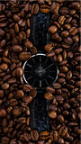 Watch in coffee beans time clock, reflaction, morning, concept. Ideas, creative photography, deadline dreams fantasy Royalty Free Stock Images