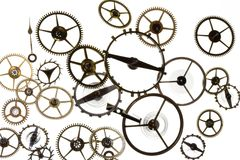 Watch Cogs. Macro of tiny watch cogs and gears on a white background Royalty Free Stock Image