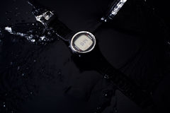 Watch computer for diving in water streams on a black background Royalty Free Stock Photography