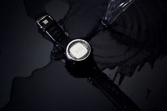 Watch computer for diving in water streams on a black background Stock Images